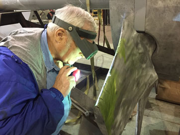 Paul examining blades for cracks
